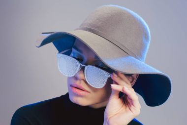woman in trendy hat and sunglasses