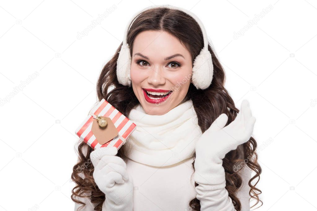 woman in winter clothes holding gift