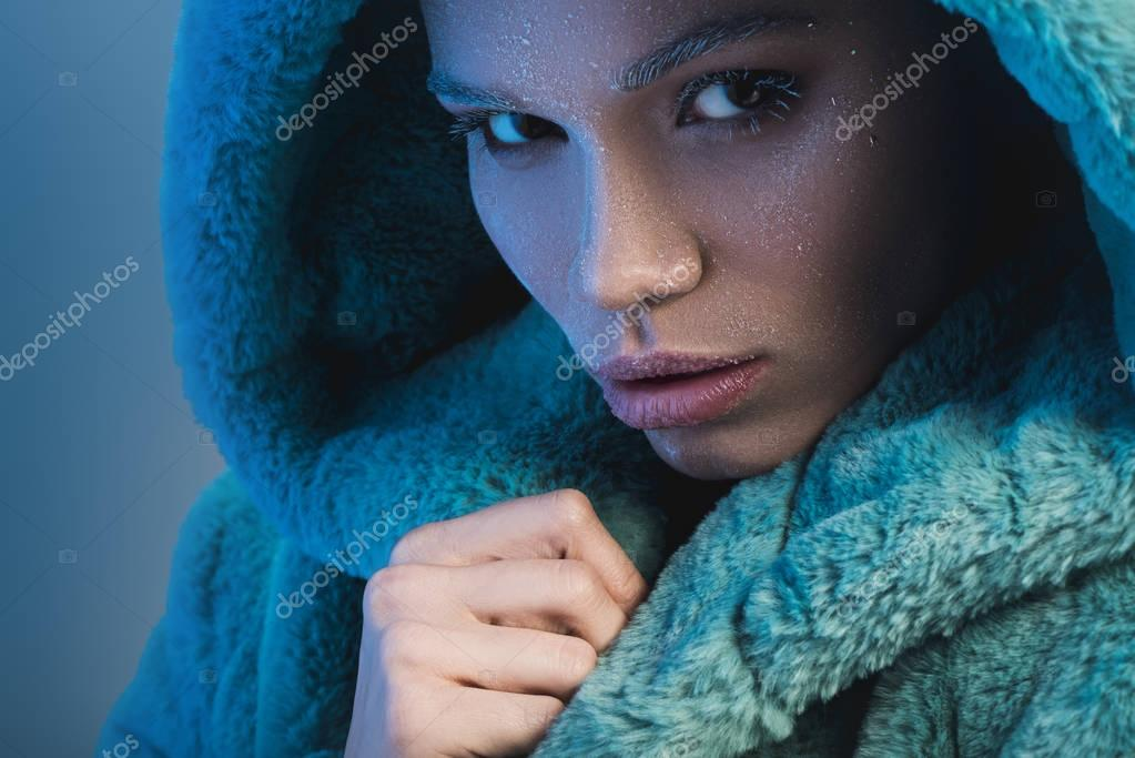 Fashionable woman covered in frost