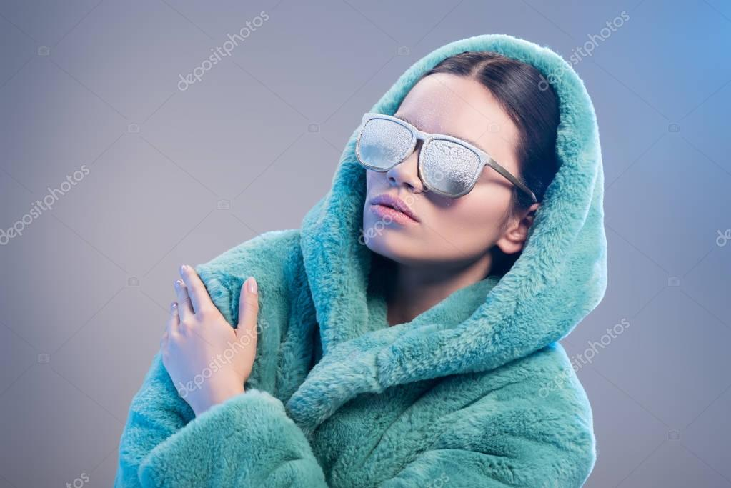 woman with frost on face wearing robe