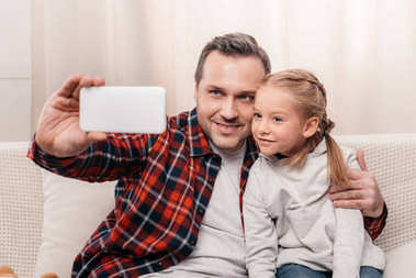 father and daughter using smartphone