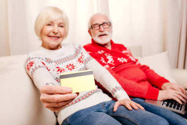 senior couple with credit card