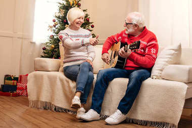 senior couple with acoustic guitar