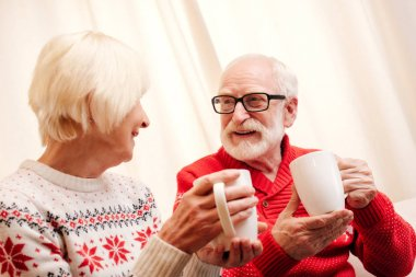 senior couple with coffee cups