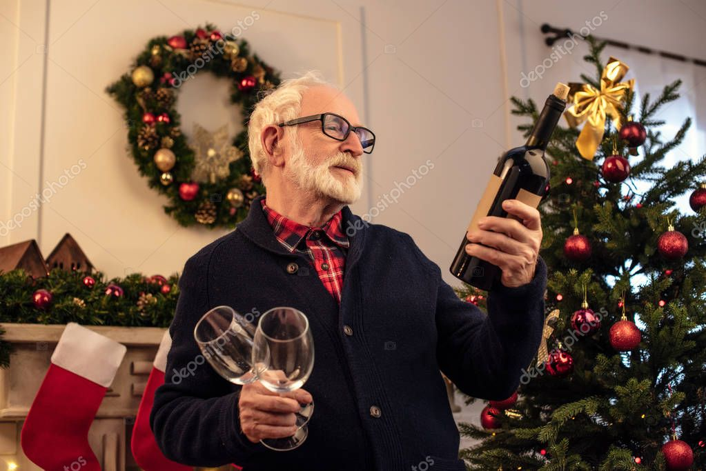 senior man with wine at christmastime