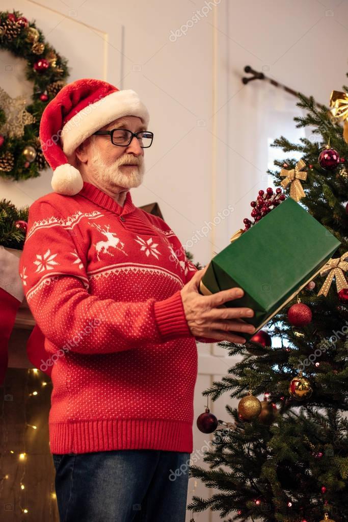 senior man with christmas gift