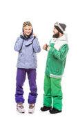 šťastný pár v snowboarding kostýmy