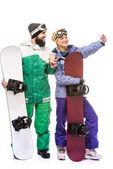 Fotografie pár s snowboardy s selfie