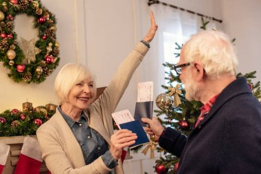 senior couple with passports and air tickets