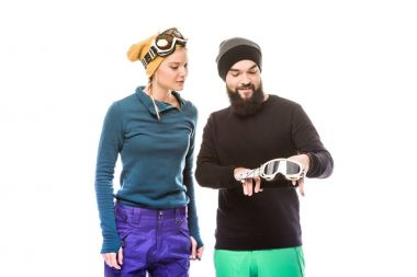 couple in hats with snowboard glasses