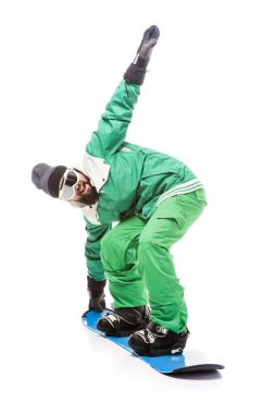 Man in snowboard costume and glasses sliding on snowboard isolated on white stock vector