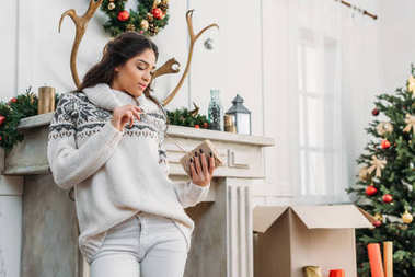 woman in christmas decorated room