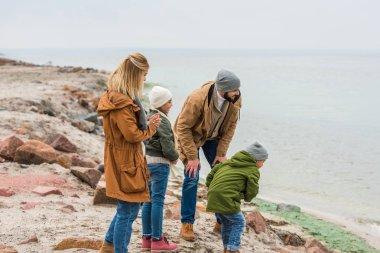 family having fun at seashore