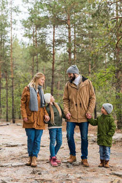 family walking by forest together