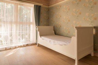 empty bed in cozy room