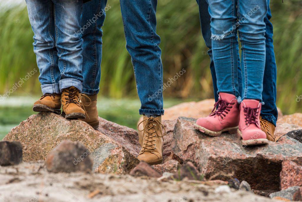 family standing on rocks