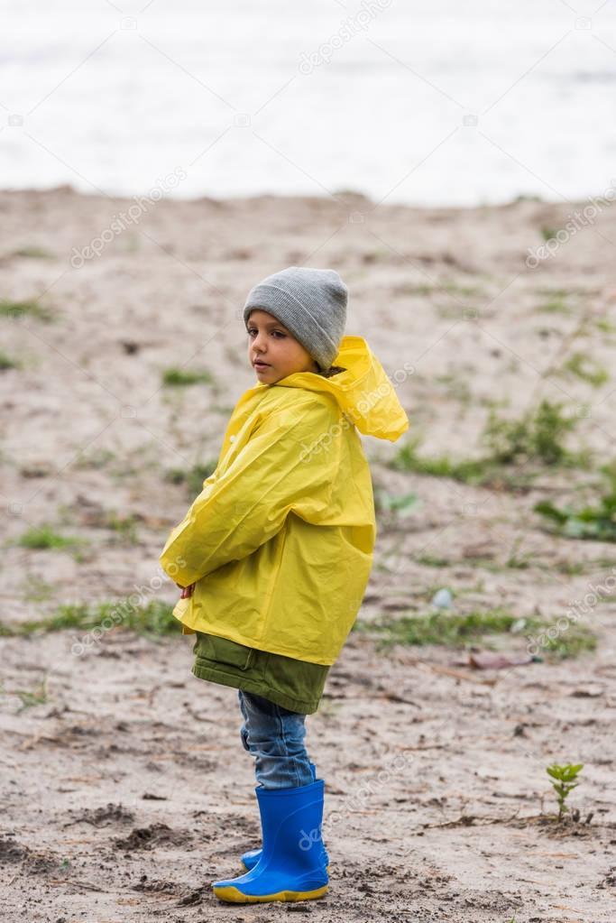 boy in yellow raincoat