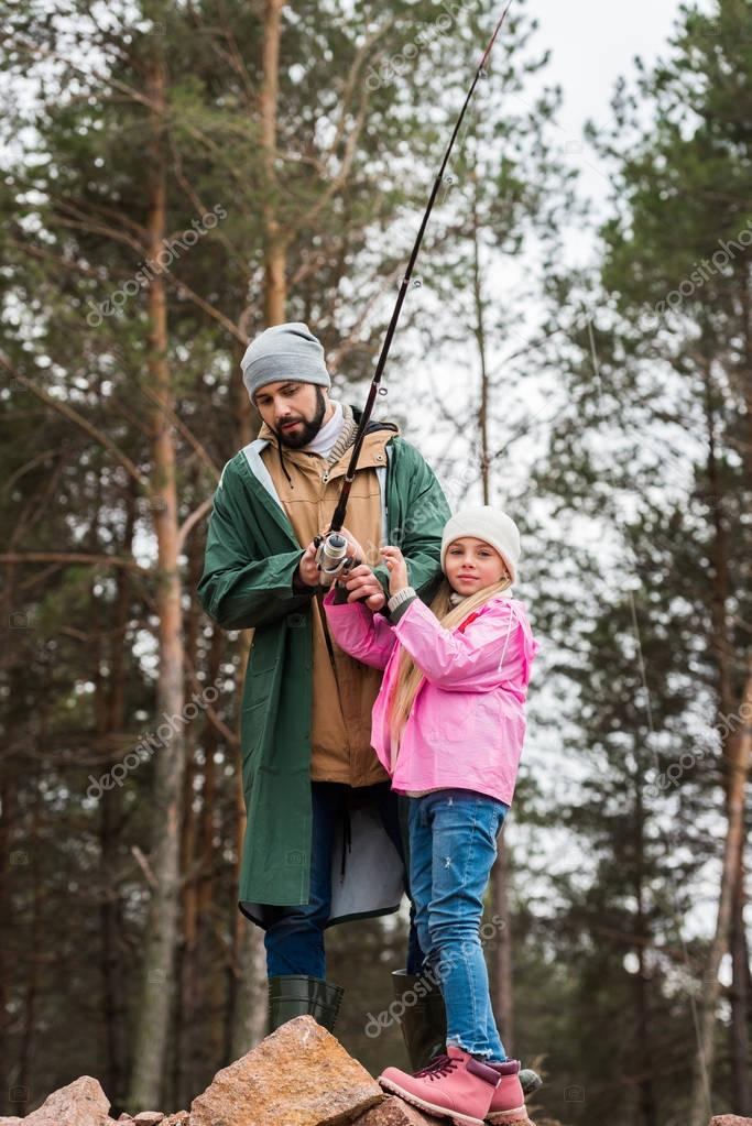 father and daughter fishing together