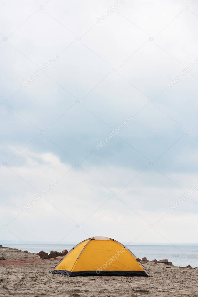 camping tent standing on seahore