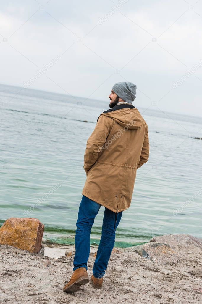 lonely man looking at sea