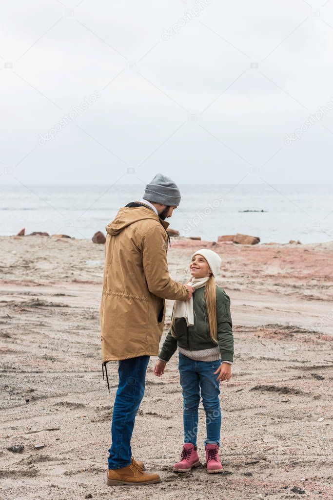 father and daughter on seashore