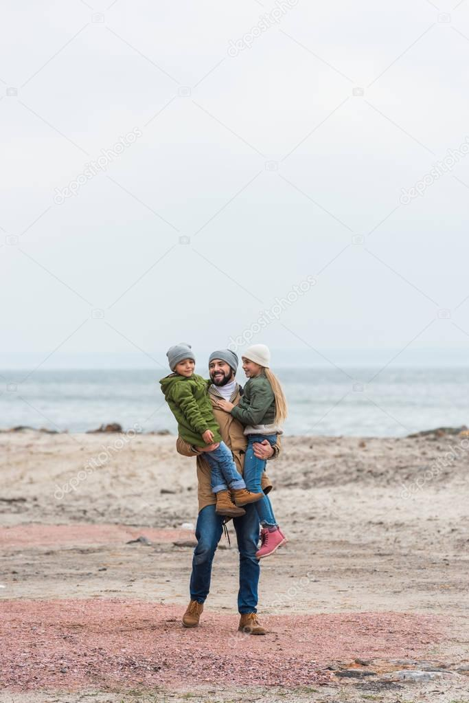 father and kids spending time on nature