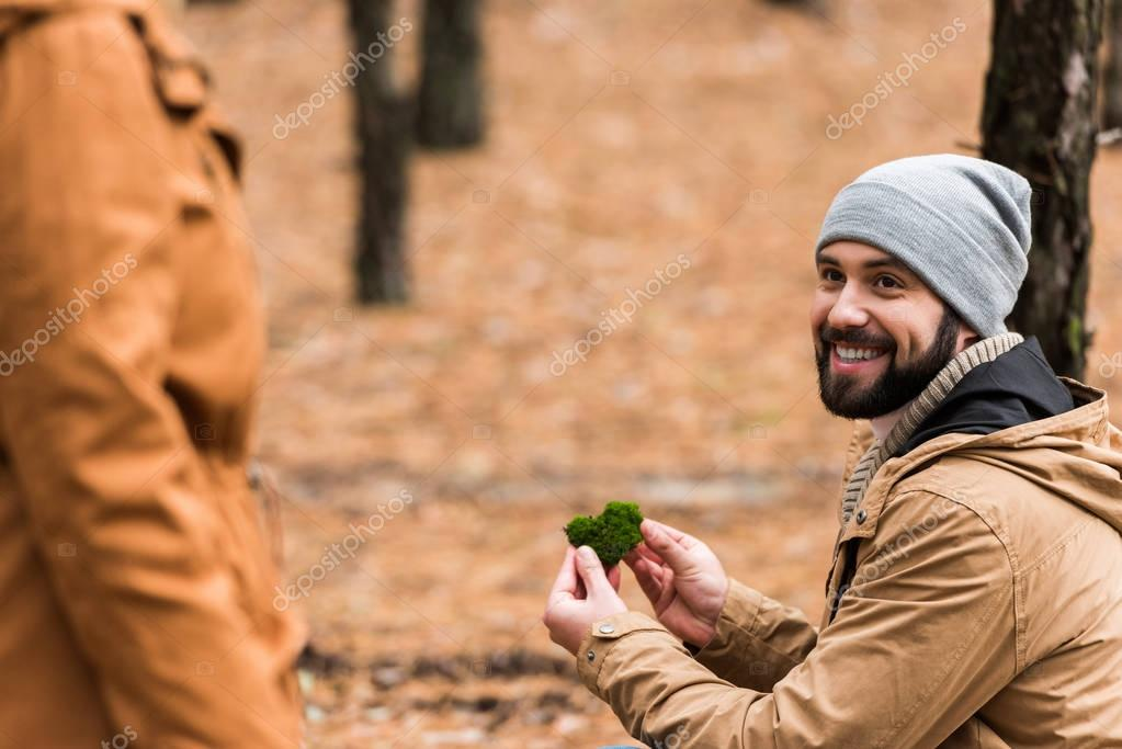 couple spending time together in forest