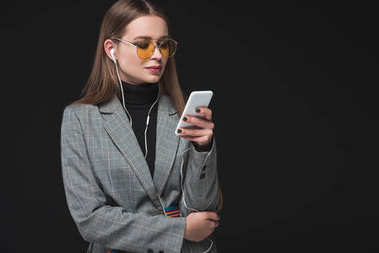 Woman listening music with smartphone