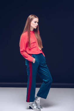 woman in stylish trousers and silver shoes