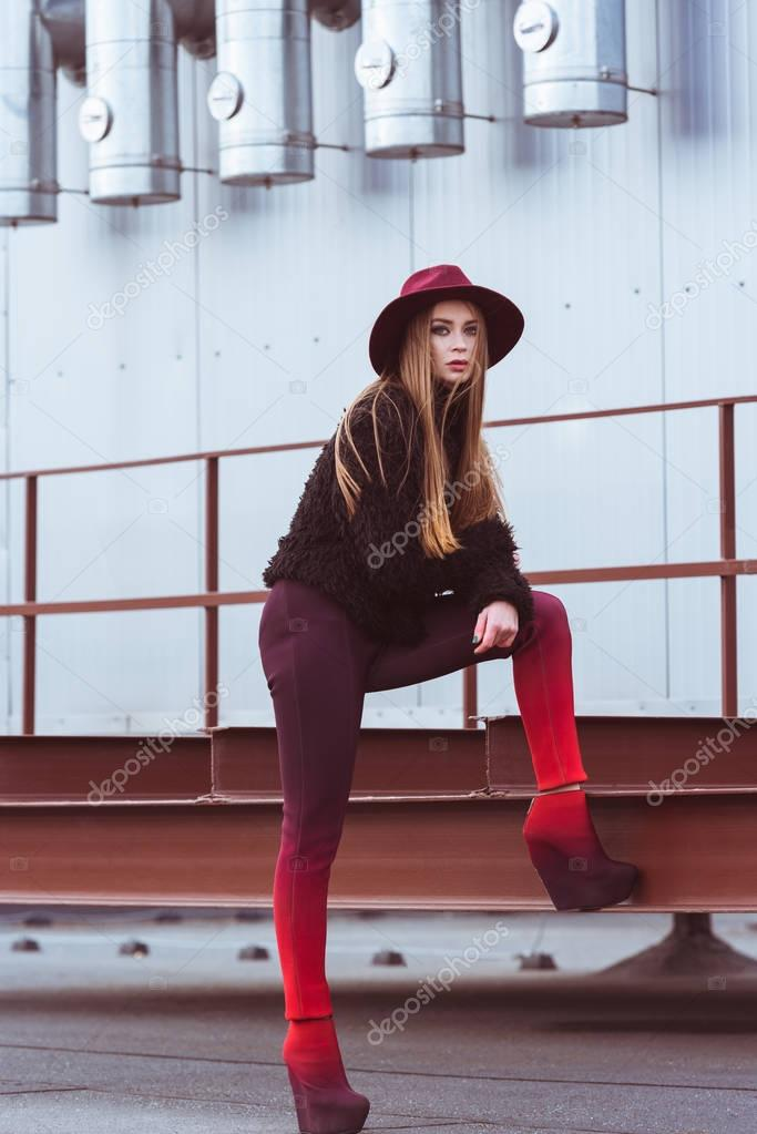 woman in burgundy hat and autumn outfit