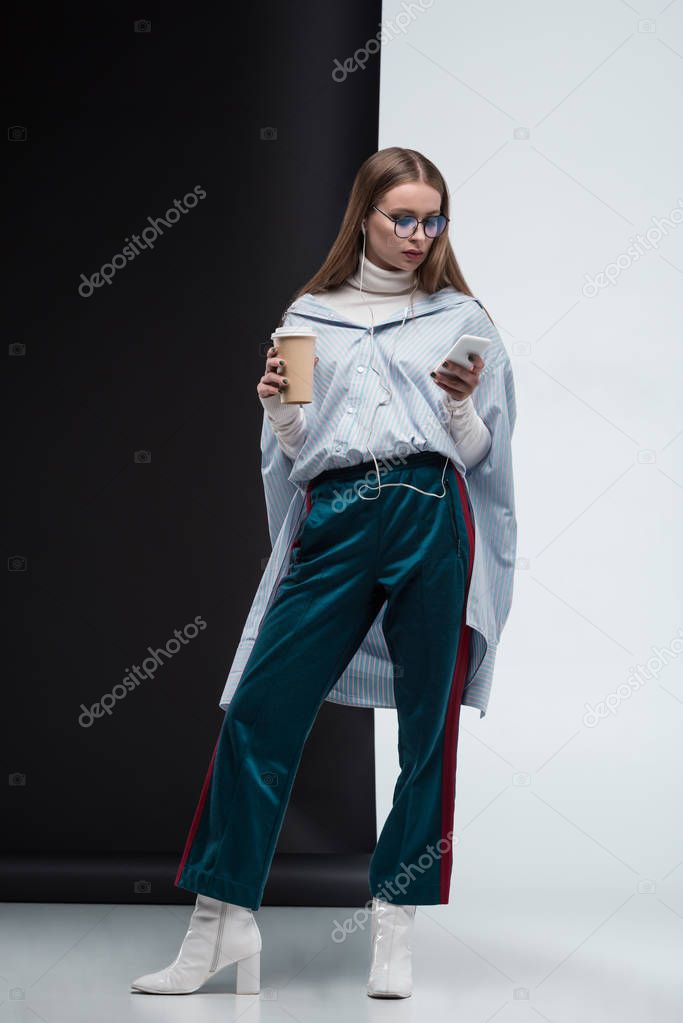 Stylish girl with smartphone and coffee