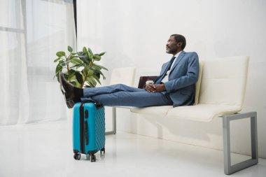 man waiting at the airport
