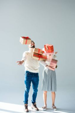 couple with wrapped christmas presents