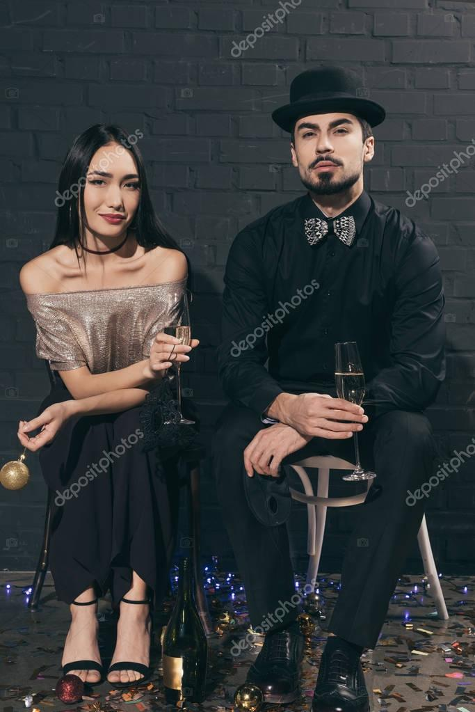 multicultural couple with glasses of champagne at party