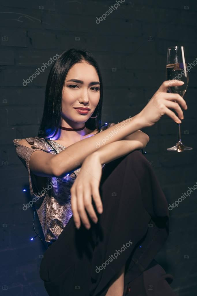 asian woman with glass of champagne