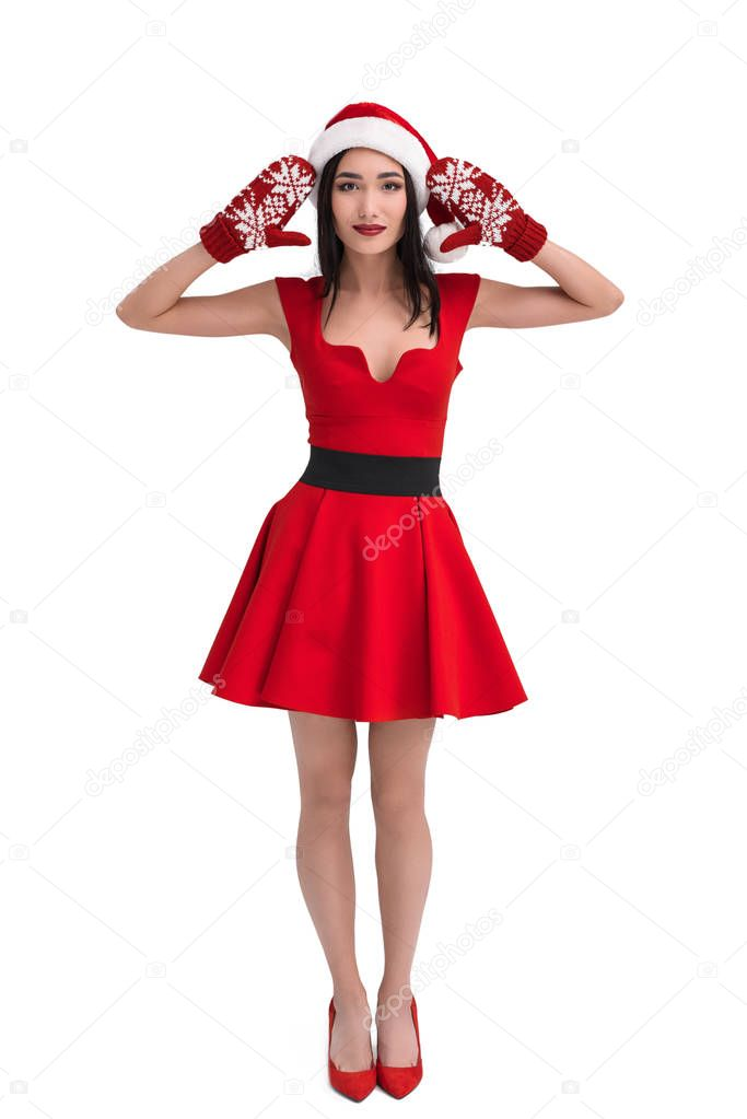 asian woman in santa costume and mittens