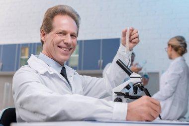 chemist holding test tube