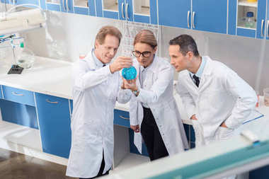 chemists examining reagent