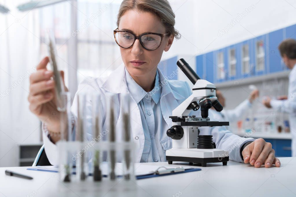 chemist working with test tube