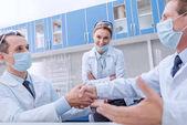 Photo doctors shaking hands