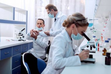 Chemist doing microscope analysis