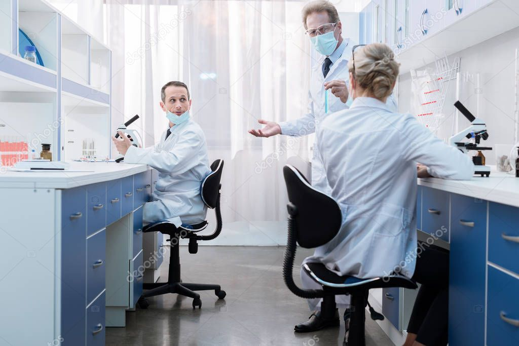 Medical workers talking in laboratory