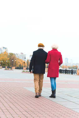 senior couple walking in city