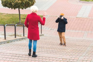 tourist couple taking photo