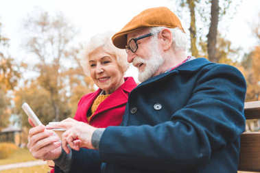 senior couple with smartphone