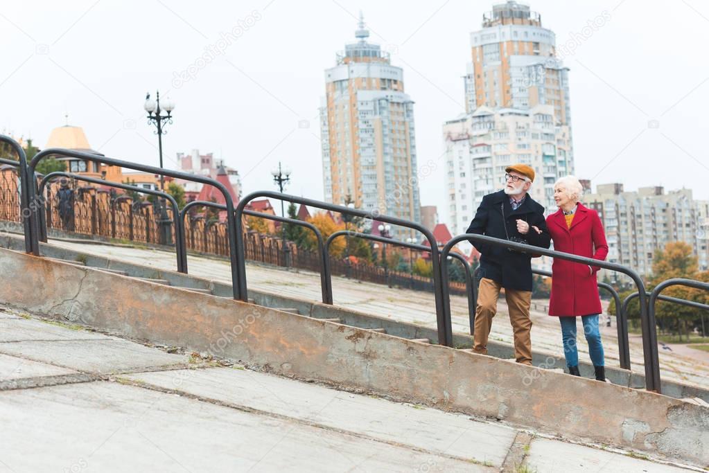 senior couple on stairs