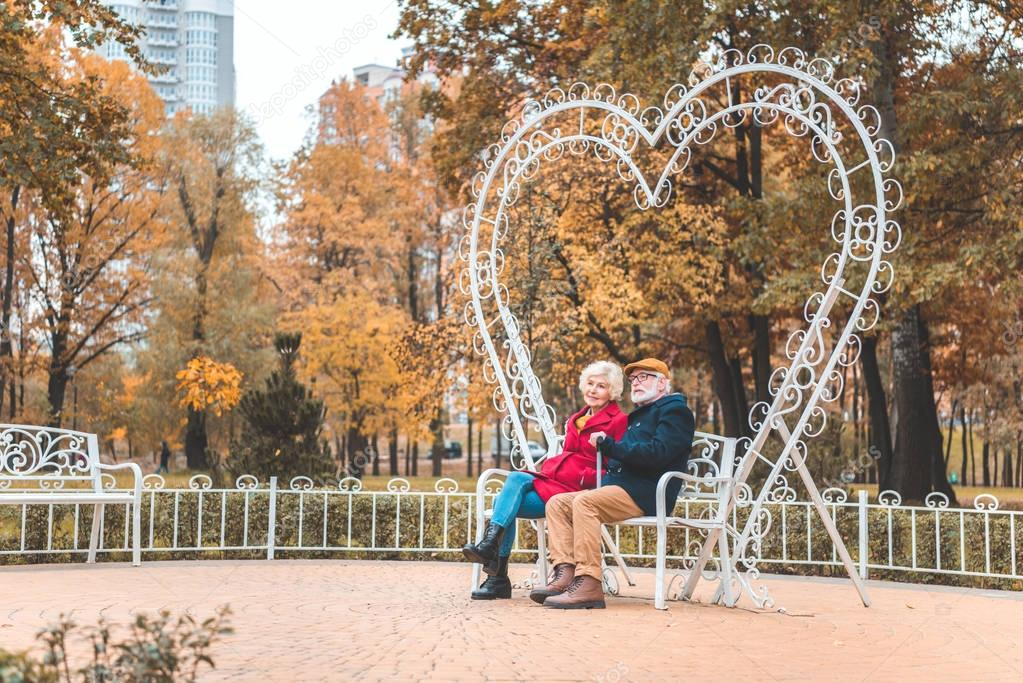 heart shaped bench in autumn park