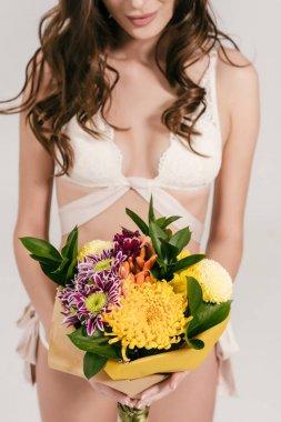 girl in lingerie holding flowers
