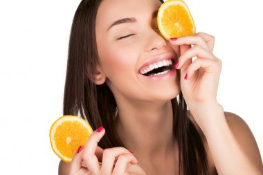 Beautiful woman with sliced orange for skincare mask for mask isolated on white stock vector