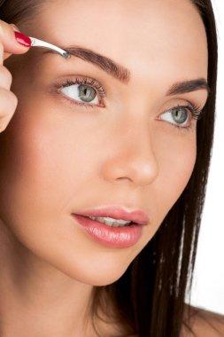 woman doing eyebrow correction